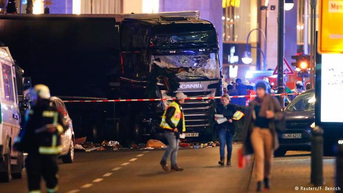Меркель, предвестник ангела смерти и грузовик в толпу Берлина